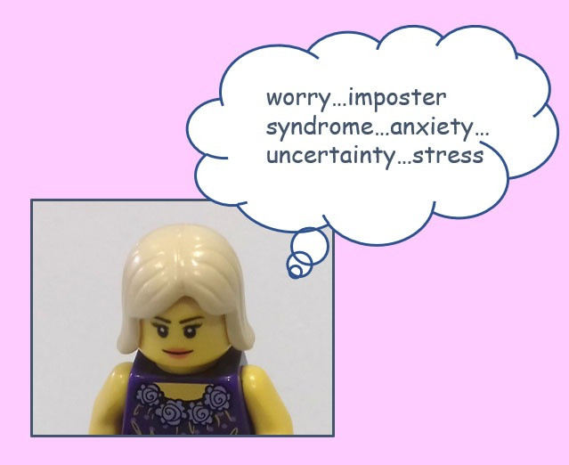 Lego person with thought bubble