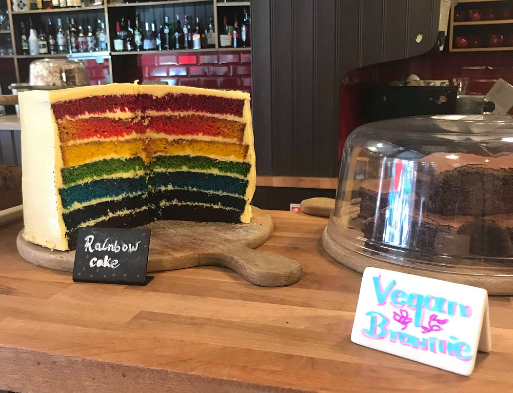 Teacup Kitchen rainbow cake on display in Norther Quarter Manchester England