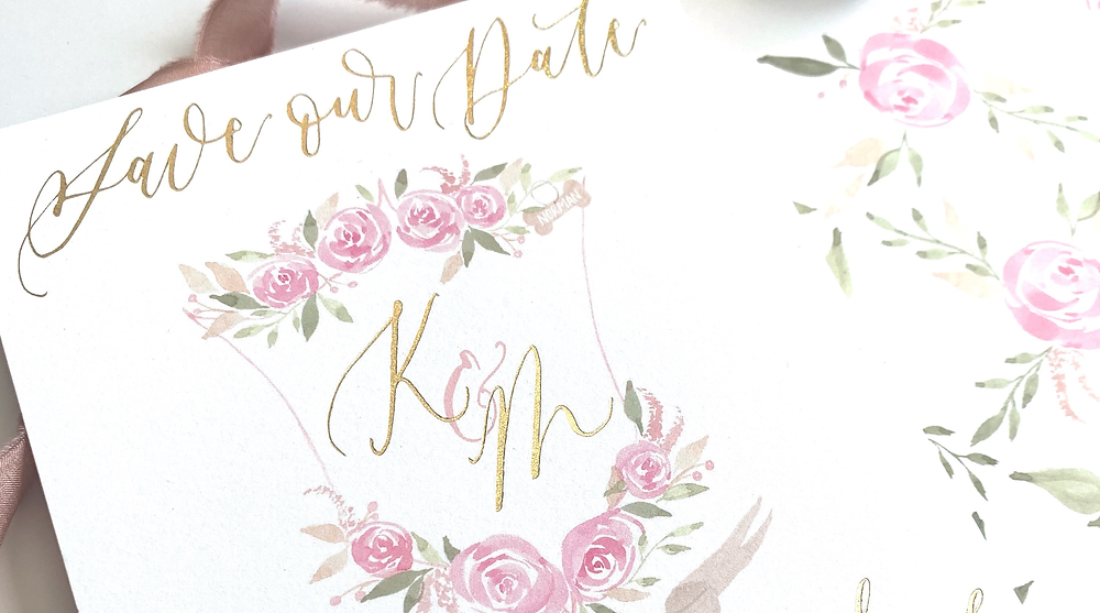 Custom save the date cards featuring gold foil printing, watercolor floral wedding crest, and spot calligraphy to make the ultimate first impression.
