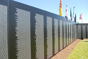 The Moving Wall Vietnam Veterans Memorial, marble panels with names of veterans who lost their lives during the Vietnam War.