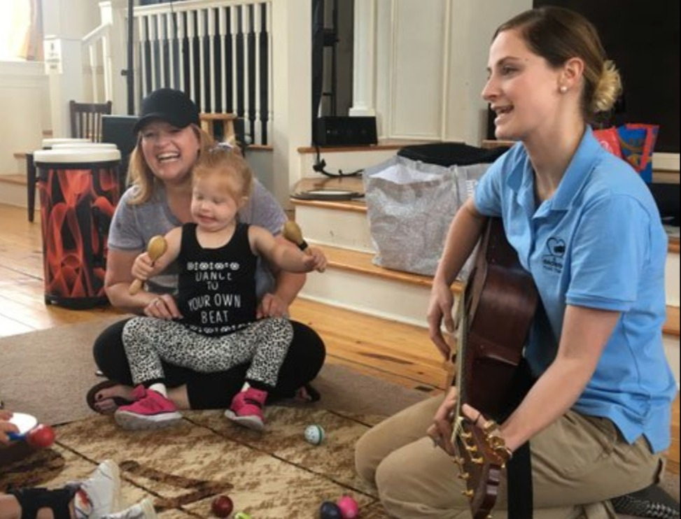 Making music with mom, child, and music therapist