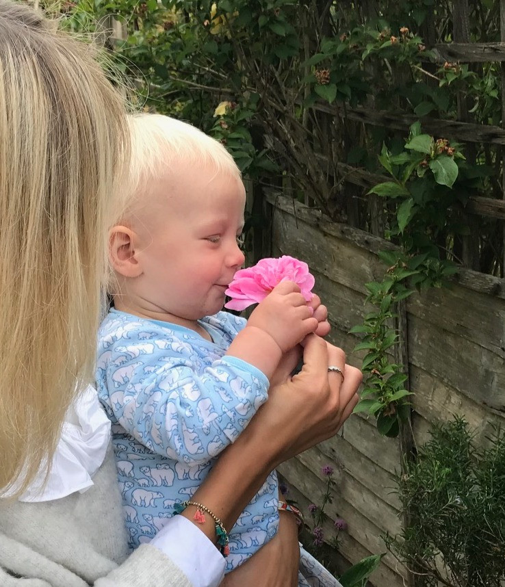 My son Bertie sniffing a rose