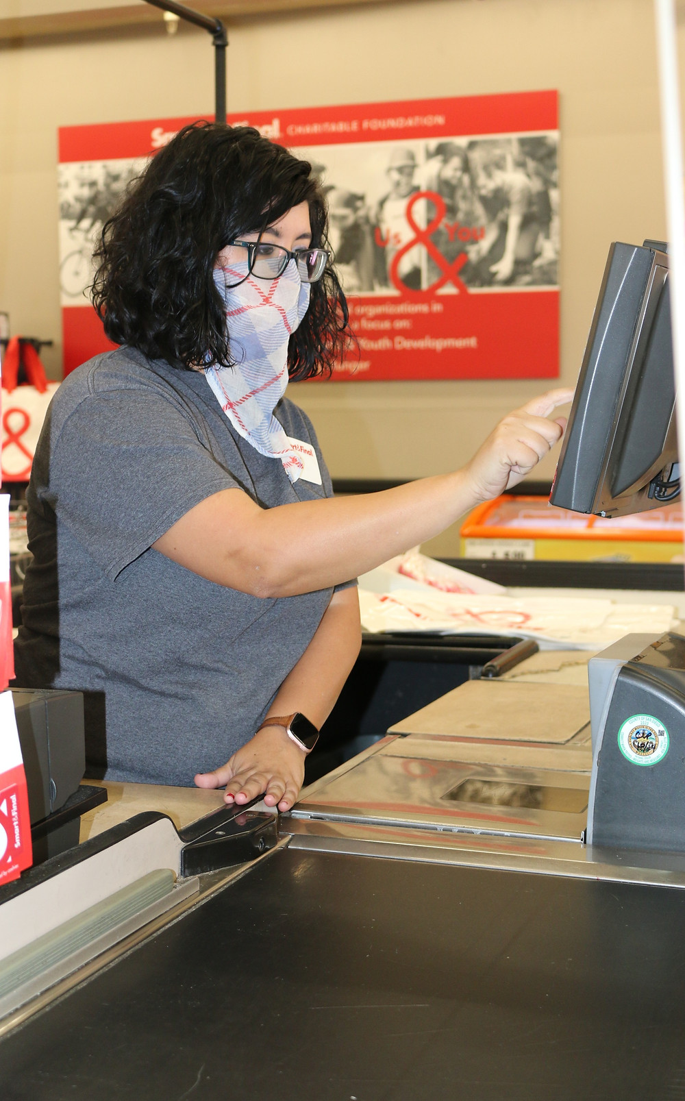 Kym operating the register at Smart & Final.