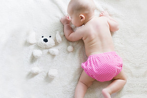 baby crawling on blanket - reusable nappies