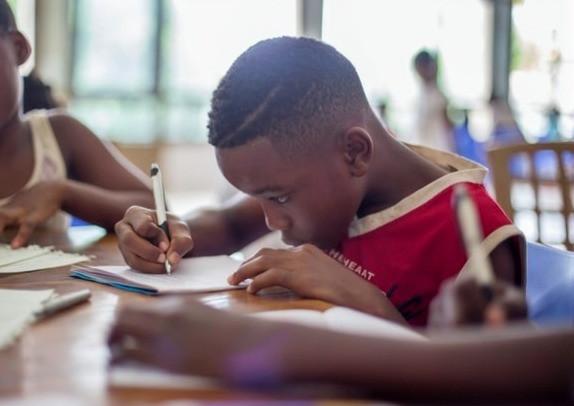 Boy practising maths