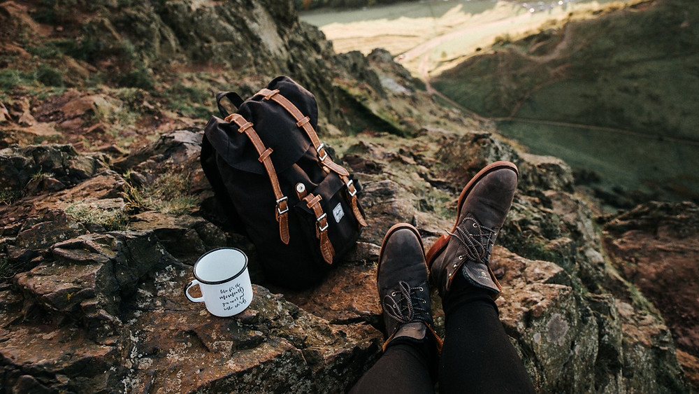 Be equipped to deal with climate change. Reduce your carbon emissions. Global warming guide, backpack, mug, mountain. Coping with climate. Sustainable living. Climate Resilience.