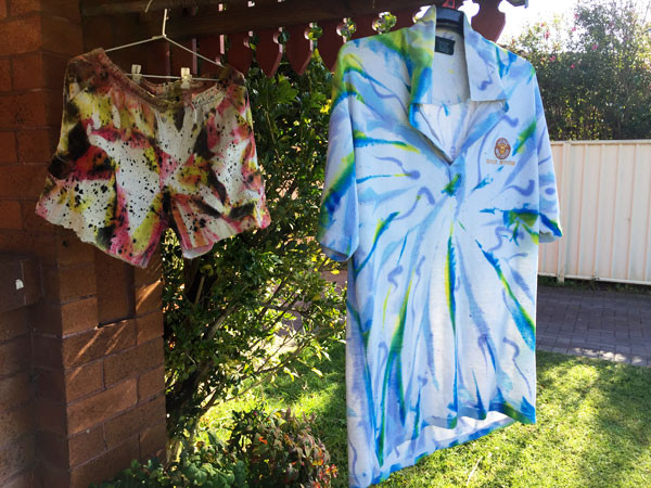 Left: swirl pattern on a previously painted shirt. Right: A pair of painted shorts and the repainted shirt.