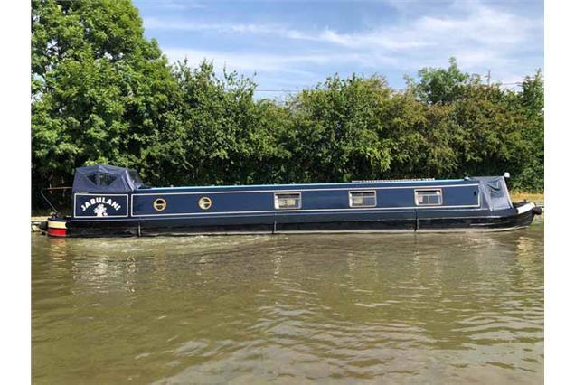 Dark blue 58' narrowboat Jabulani, on the Grand Union Canal