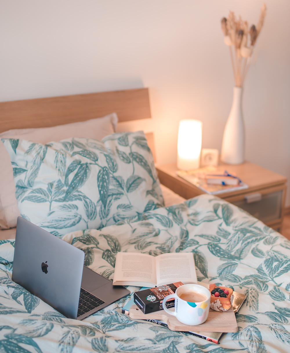Working from home set up on a bed