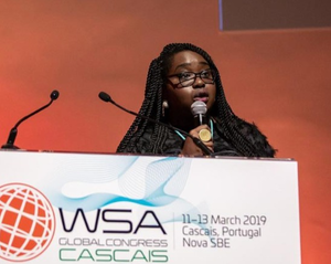 Dr. Helen Zidon speaking at a global conference in Portugal