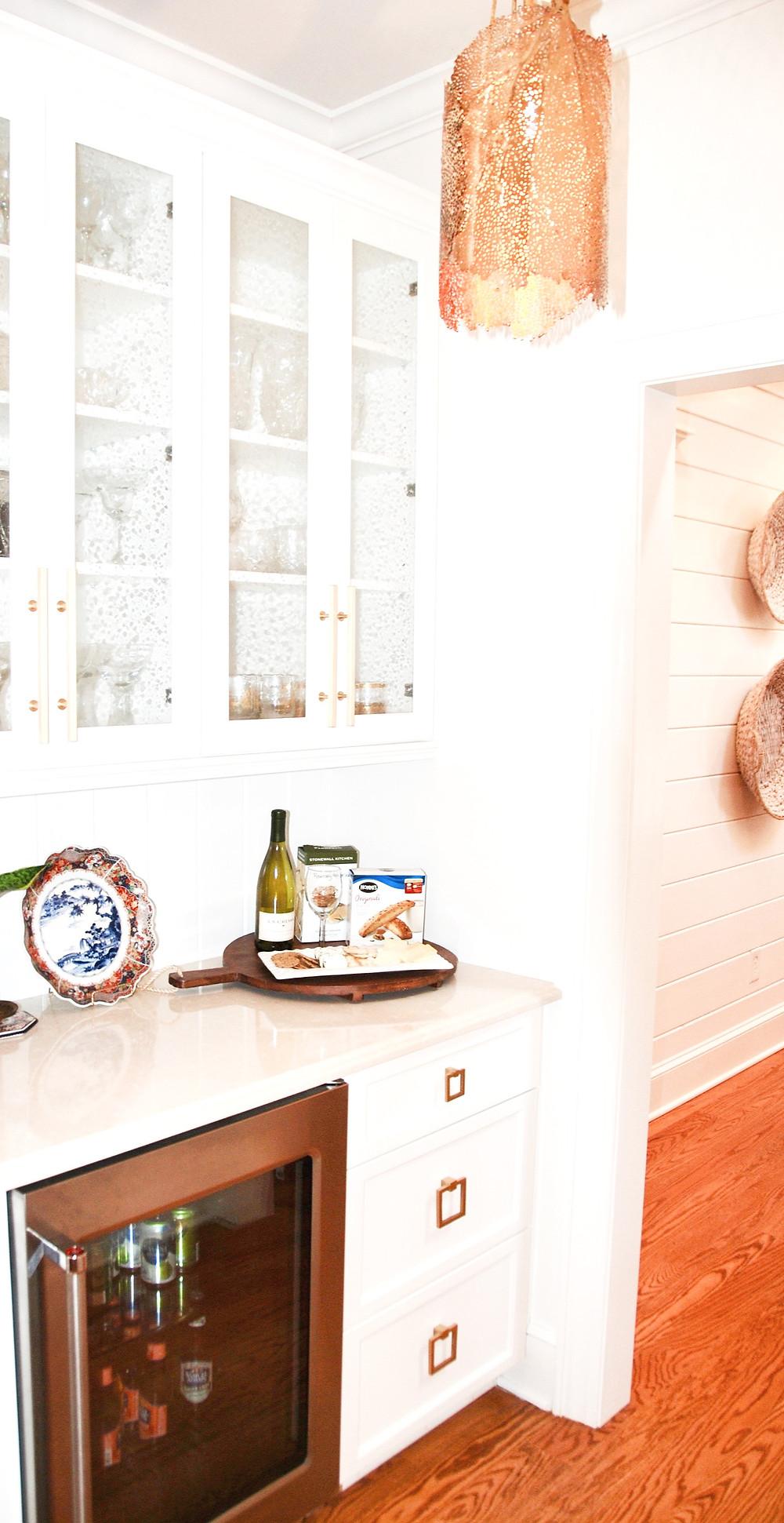 modern coastal kitchen wet bar seedy glass gold hardware fan light