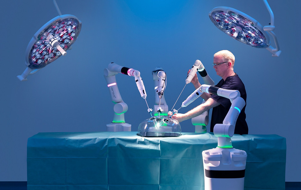 A man working in an operating room by using robotic systems to improve too improve hospital experiences