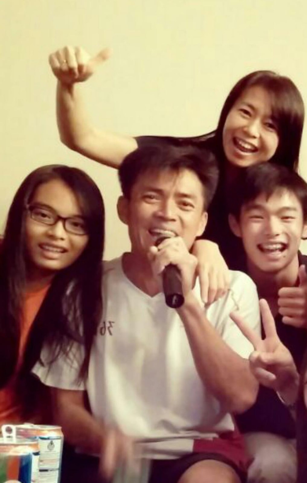 Mr Melvin Tan and his family