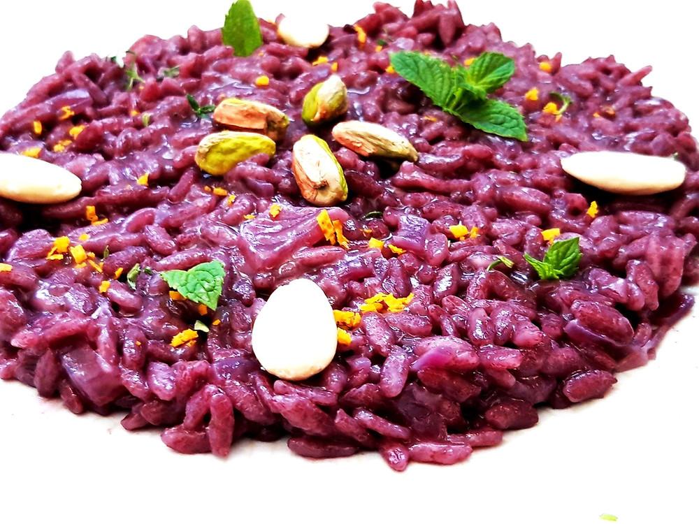 Risotto al Nero d'Avola con pistacchi, mandorle e scorza di arancia