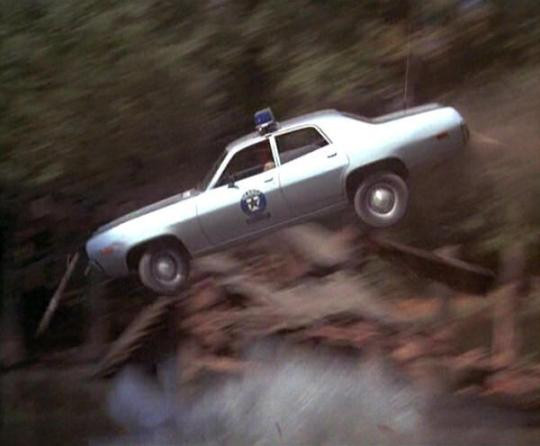 A 1972 Plymouth Satellite crashes back to earth in the sad and somber film, Smokey and the Bandit.