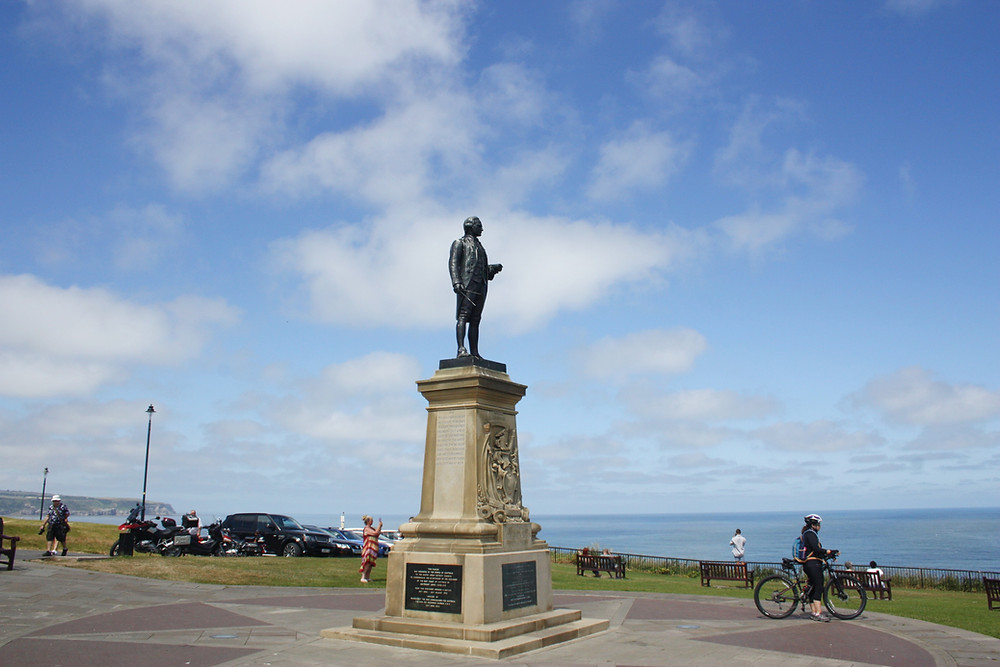 Captain Cook statue standing at the top of a hill in Whitby England