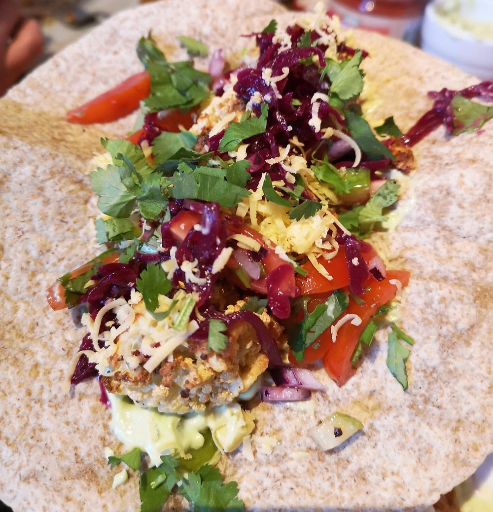 Crispy Cauliflower Tacos with Reclaimed Red Kraut, grated cheese, fresh coriander and tomato salsa
