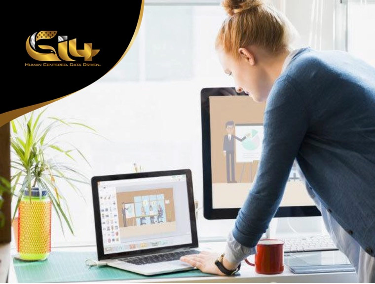 Woman working on computer with animation software