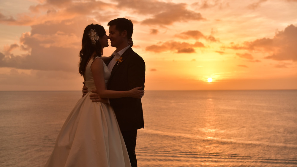 Sun setting behind newlyweds at Sandals St Lucia La Toc