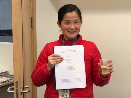Dr Yu Sun celebrating her success in her PhD Viva - congratulations from the Rushworth Lab