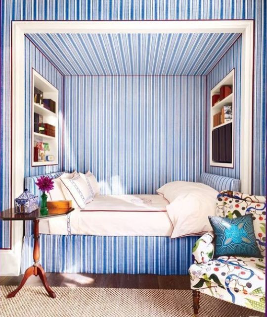 upholstered headboard, Katie Ridder, upholstered walls, bedroom walls, interesting walls, bed alcove, bed niche, bed cove, blue stripes, blue stripe walls, blue bed, blue bedroom, bedroom, classical bedroom, classic bedroom