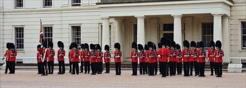 Guards prepare for the changing of the guard at Buckingham Palace London