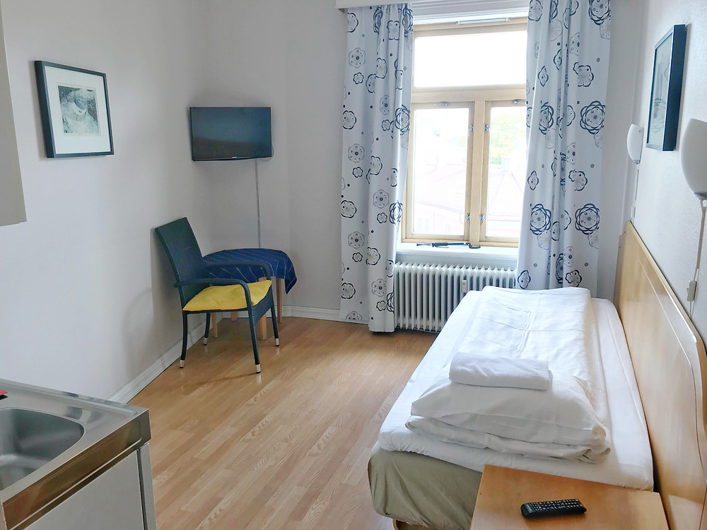 Premium single room with kitchen inside Cochs Pensjonat in Oslo, Norway