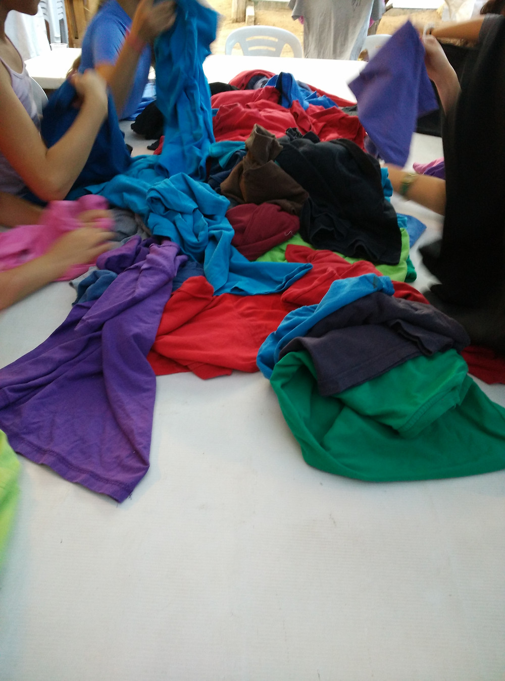 Pile of t shirts for upcycling