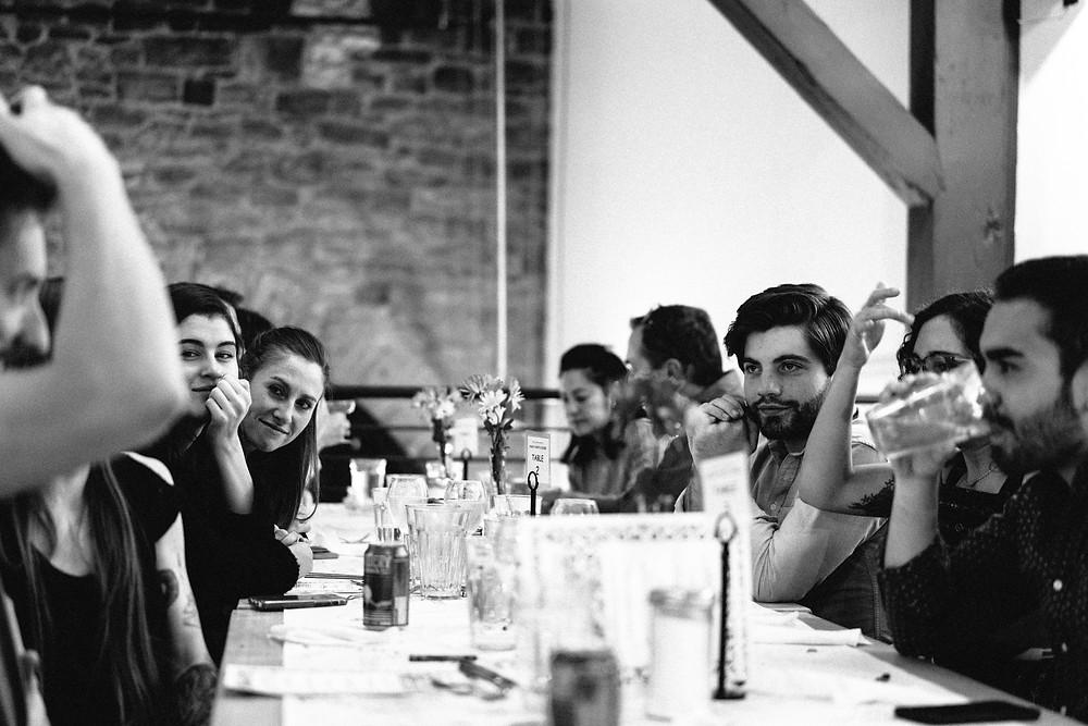 Guests enjoying conversation at dinner