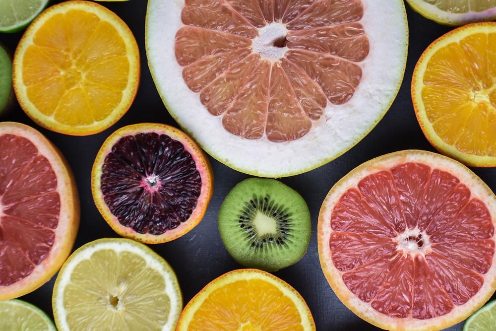 Variety of fruits sliced in half
