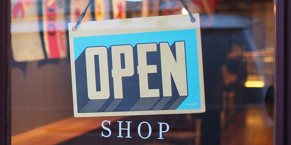 Shop OPEN sign on door