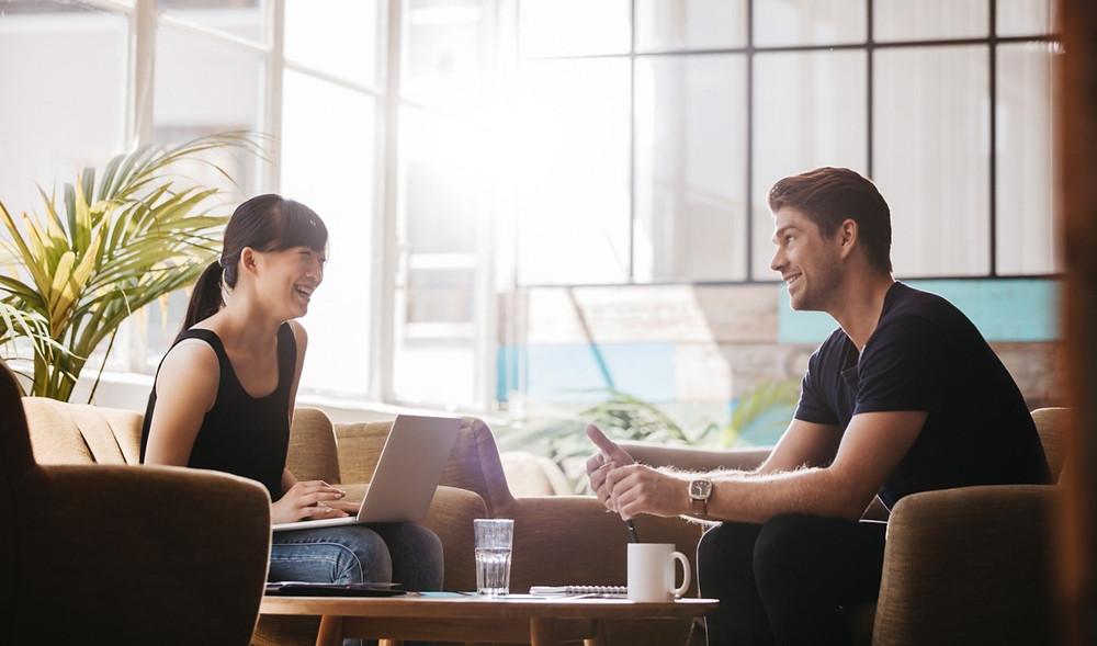 Two people talking in office