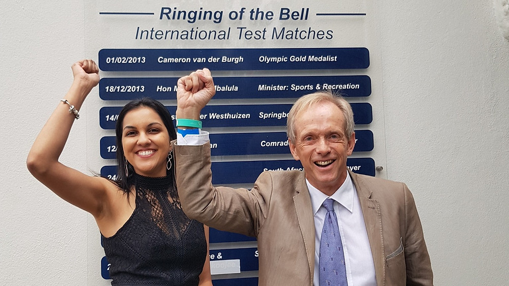 Esha Mansingh and Bruce Fordyce, ultramarathon legend, after they rang the bell at Wanderers Cricket Ground, South Africa.