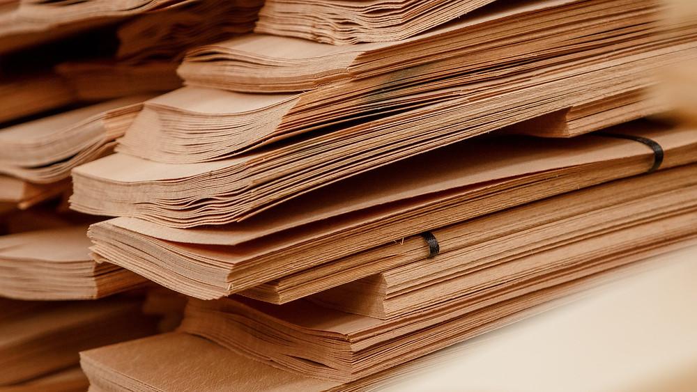 Multiple wooden veneer sheets