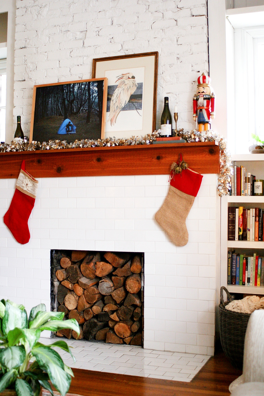 A mantel decorated by Lauren Figueroa Interior Designs.