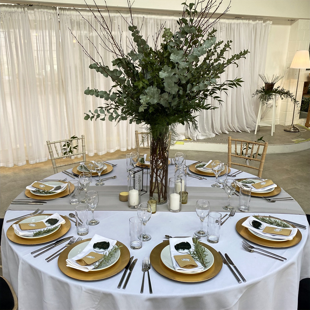 irnham hall wedding guest tables with gold plates and greenery