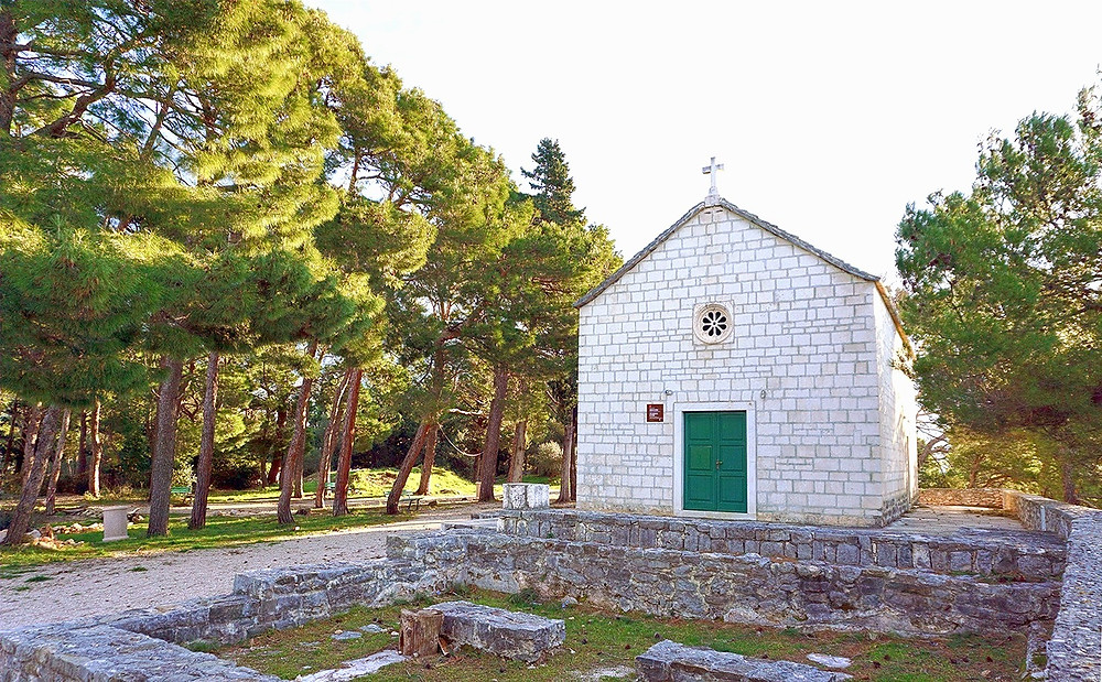 Church and courtyard on St Peter's peninsula in Makarska, Croatia are a good place for a relaxing walk in the shade of pines