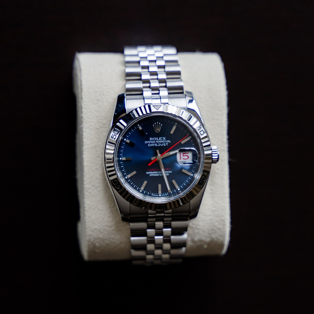Rolex reference number 116264 turn o graph with blue face and jubilee bracelet
