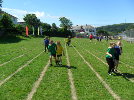 Practising Athletics and Rounders in Year 3