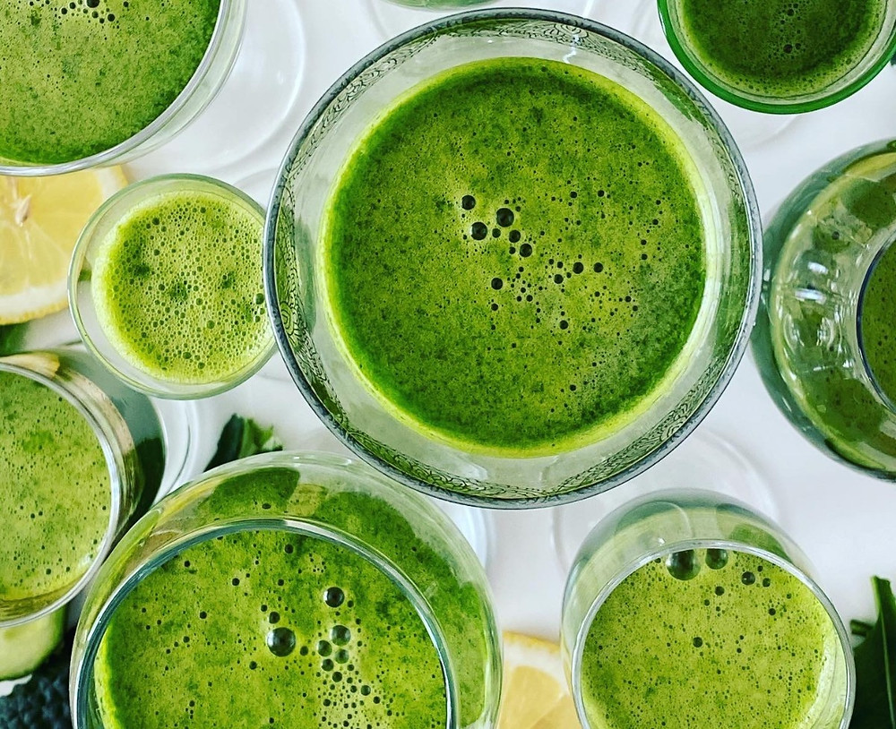 A selection of glasses containing Nicole's green juice. Image source: Nicole Cullinan @wellnessplaceint
