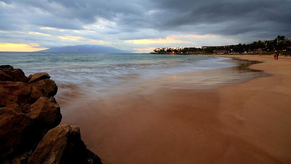 Wailea Beach long exposure waves rushing out toward the sea in Maui, Hawaii