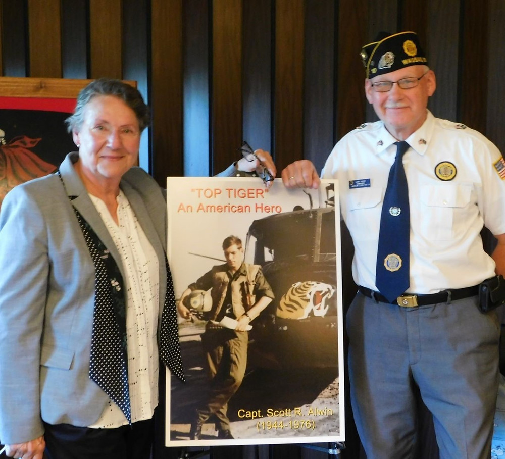 Pamela Fullerton, Legion Post 10 Commander and photo of Scott Alwin