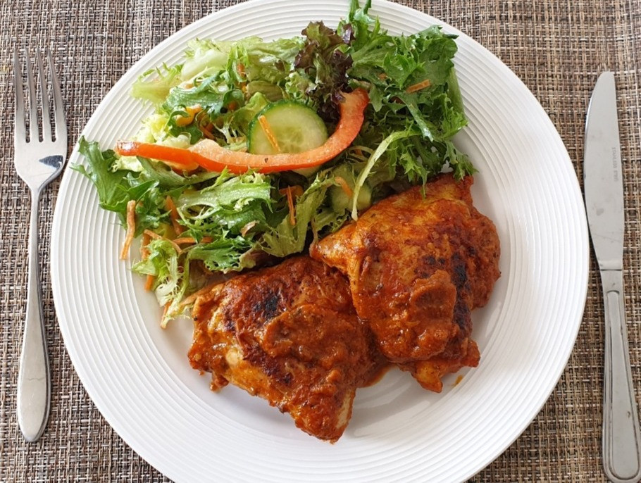 pan fried chicken, green salad, chilli pepper sauce, peri peri sauce
