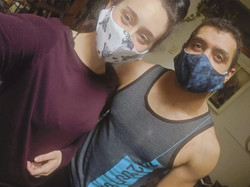 two people wearing cloth masks