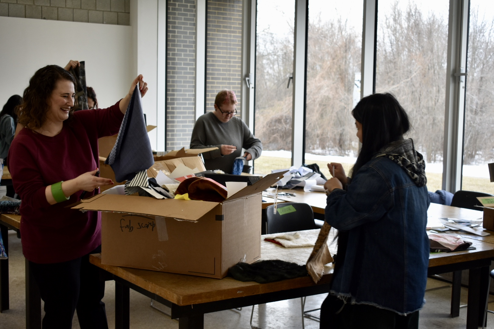 Professor Polak holds up a piece of fabric. (Photo by Sierra Petro)