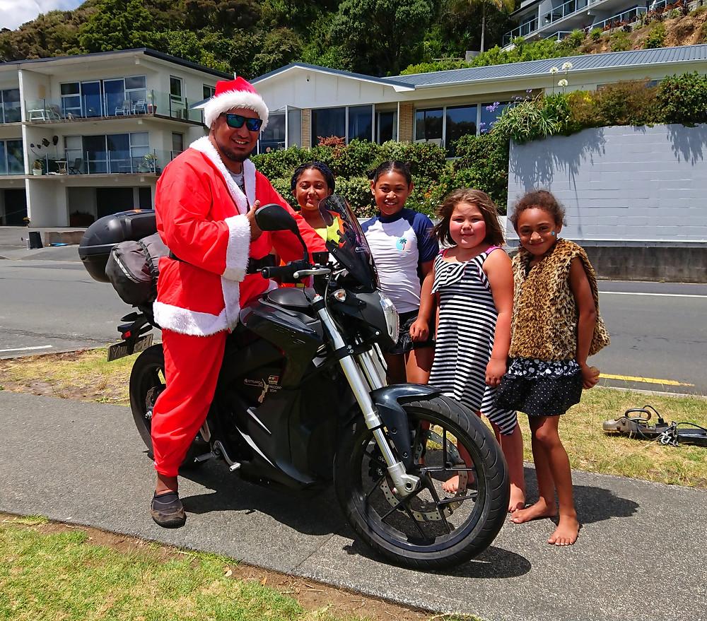 Maori Santa on Zero Motorcycle New Zealand Top to bottom tour
