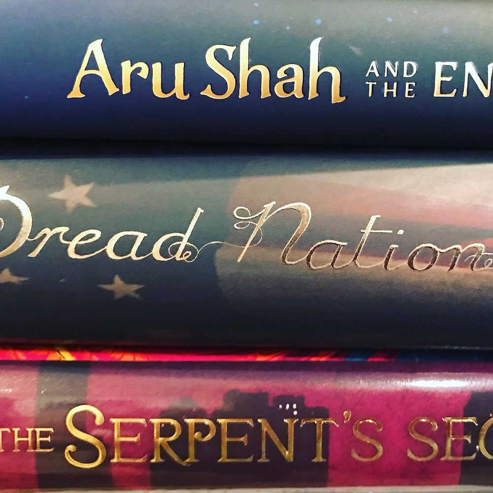 Three book stacked up: Aru Shah and the End of Time, Dread Nation, The Serpent's Secret