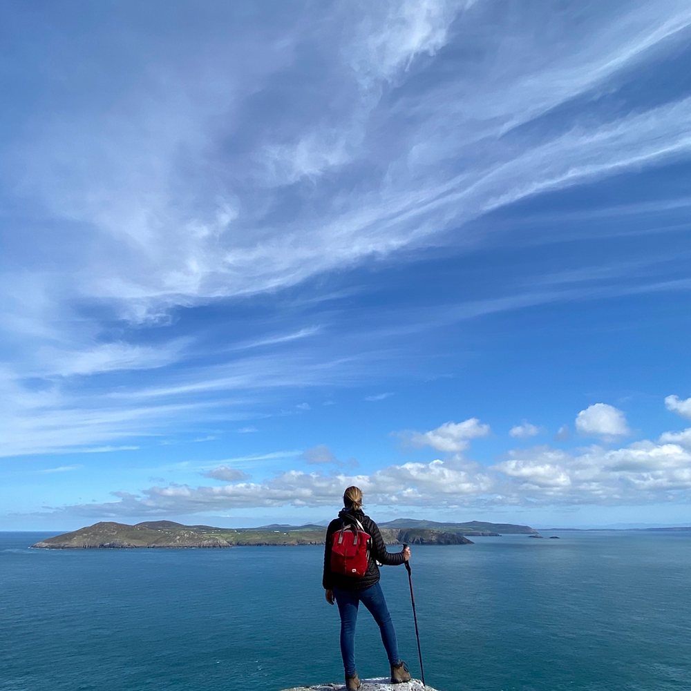 A woman looking across from Bardsey Island towards the Llyn Peninsula on the mainland