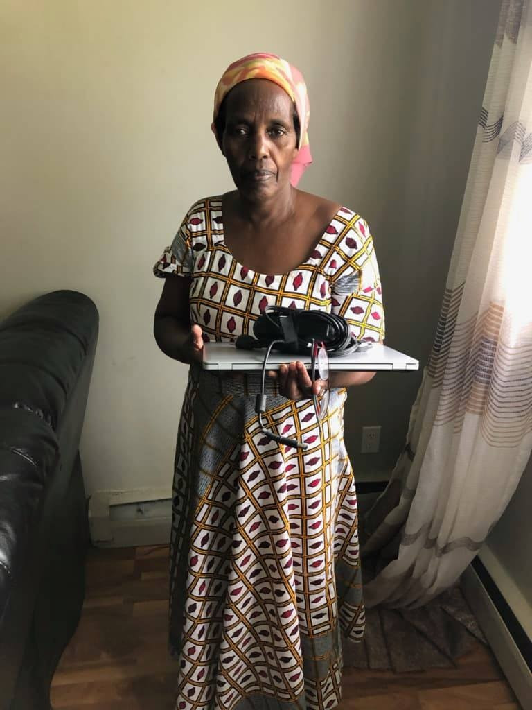 NE Hub Client receiving a laptop from the laptop drive