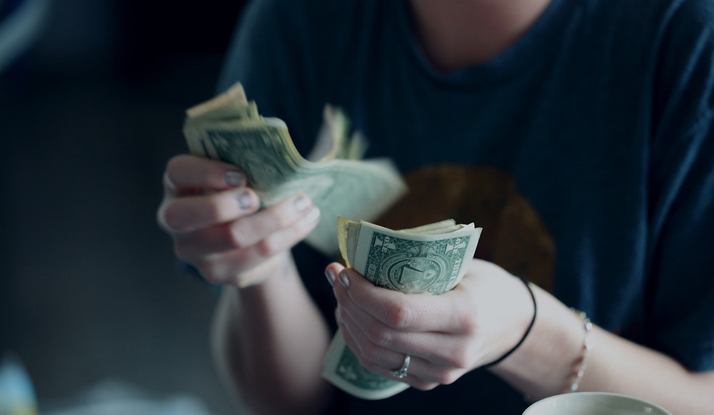 Counting money to pay yourself first, single dollar bills